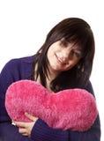 Muchacha con el corazón del juguete. Fotos de archivo