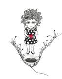 Muchacha con el corazón rojo cerca del agujero Fotos de archivo