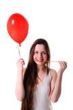 Muchacha con el corazón rojo del globo Fotografía de archivo