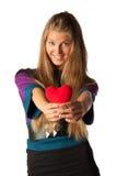 Muchacha con el corazón rojo en manos Imagenes de archivo