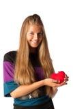 Muchacha con el corazón rojo en manos Imagen de archivo libre de regalías