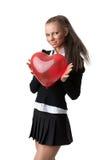 Muchacha con el corazón rojo en manos Imagen de archivo
