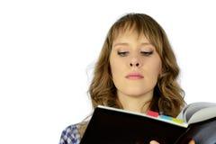 Muchacha con el cuaderno. Fotos de archivo