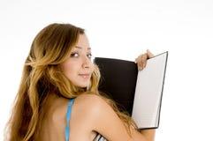 Muchacha con el cuaderno abierto Imágenes de archivo libres de regalías