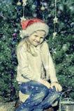Muchacha con el decoartion de la Navidad Fotos de archivo libres de regalías