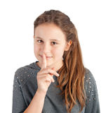 Muchacha con el dedo en sus labios Imágenes de archivo libres de regalías
