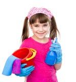 Muchacha con el espray a disposición listo para ayudar con la limpieza en blanco Imagen de archivo libre de regalías