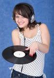 Muchacha con el expediente de vinilo Foto de archivo libre de regalías