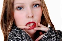 Muchacha con el finger en los labios Imagen de archivo libre de regalías