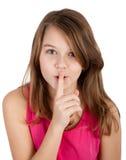 Muchacha con el finger en sus labios Fotografía de archivo libre de regalías