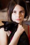 Muchacha con el gatito Imagenes de archivo