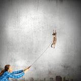 Muchacha con el gato Fotografía de archivo