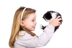 Muchacha con el gato del bebé Imagen de archivo