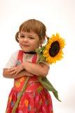 Muchacha con el girasol Imagen de archivo