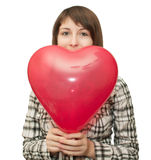 Muchacha con el globo bajo la forma de corazón Fotografía de archivo