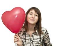 Muchacha con el globo bajo la forma de corazón Fotos de archivo