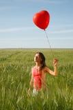 Muchacha con el globo rojo Imagen de archivo