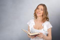 Muchacha con el libro aislado Imagenes de archivo