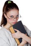Muchacha con el libro aislado en un blanco Imagenes de archivo