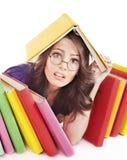 Muchacha con el libro del color de la pila. Imagenes de archivo