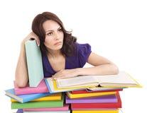 Muchacha con el libro del color de la pila. Foto de archivo libre de regalías