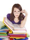Muchacha con el libro del color de la pila. Fotografía de archivo
