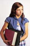 Muchacha con el libro y la carpeta Imagen de archivo