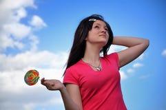 Muchacha con el lollipop Imagenes de archivo