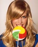 Muchacha con el lollypop Imagen de archivo