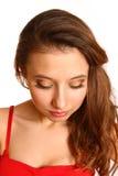 Muchacha con el maquillaje que parece abajo aislado en el fondo blanco Foto de archivo libre de regalías