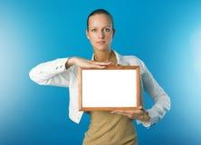 Muchacha con el marco Imagen de archivo libre de regalías