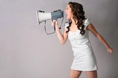 Muchacha con el megáfono Fotografía de archivo libre de regalías
