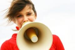Muchacha con el megáfono Foto de archivo libre de regalías