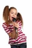 Muchacha con el micrófono Foto de archivo