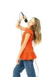 Muchacha con el micrófono Fotografía de archivo