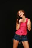 Muchacha con el micrófono Foto de archivo libre de regalías
