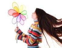 Muchacha con el molino de viento del colorfull Imagen de archivo