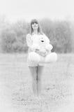 Muchacha con el oso de peluche Fotos de archivo