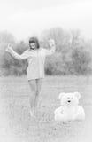 Muchacha con el oso de peluche Imagen de archivo