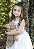 Muchacha con el oso del peluche fotografía de archivo