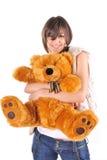 Muchacha con el oso del peluche Foto de archivo