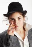 Muchacha con el palillo del pretzel Imagen de archivo libre de regalías
