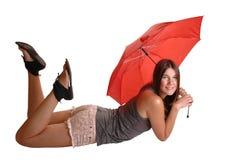 Muchacha con el paraguas. Imagen de archivo libre de regalías