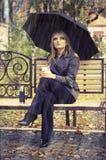 Muchacha con el paraguas Fotografía de archivo