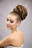 Muchacha con el peinado y el maquillaje Imagen de archivo