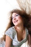 Muchacha con el pelo del vuelo Foto de archivo libre de regalías