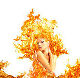 Muchacha con el pelo fuera del fuego Imagen de archivo