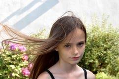Muchacha con el pelo que sopla Foto de archivo