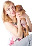 Muchacha con el perrito de Dogue de Bordeaux Imagen de archivo