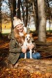 Muchacha con el perro Imagen de archivo